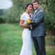 bride and groom in the orchards at Saint hubert's Lodge