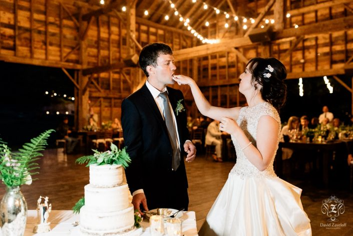 bride and groom cake cutting - handsome hollow wedding