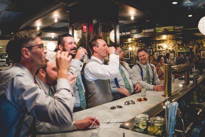 groomsmen at the bar
