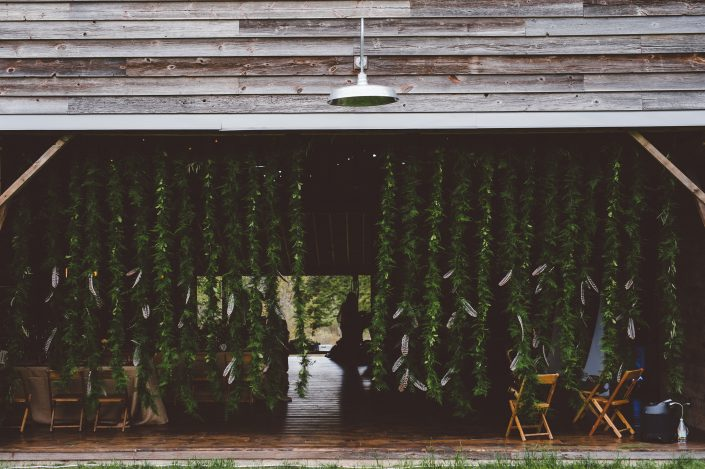 greenery and feathers entranceway - barn wedding