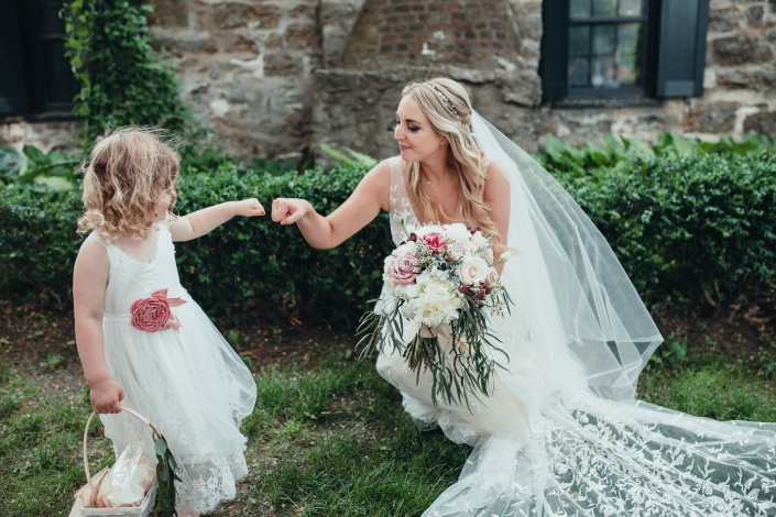 fist bump flower girl