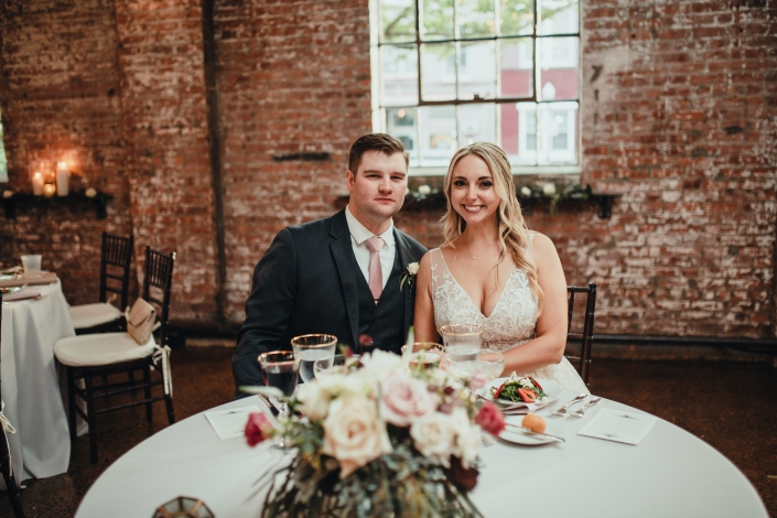 bride and groom at sweetheart table - senate garage