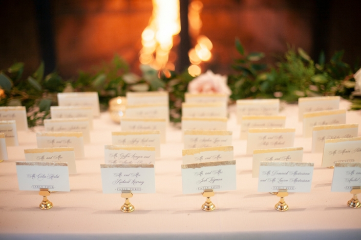 escort cards in front of fire place - mohonk