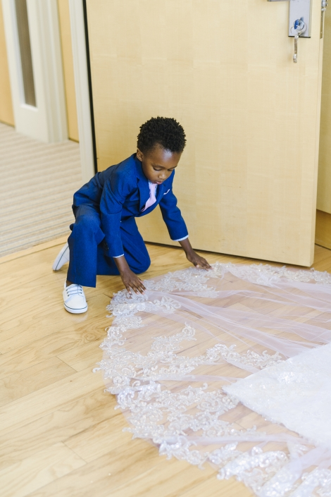 ring bearer fixing brides dress
