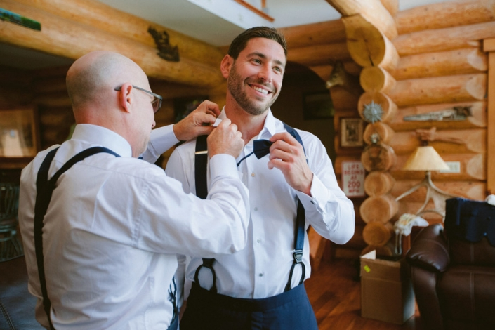 groom getting ready at Scribner's lodge