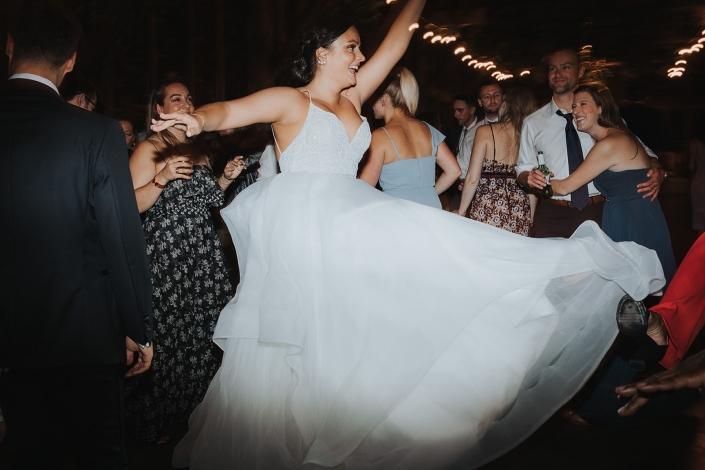 bride dancing - barn wedding