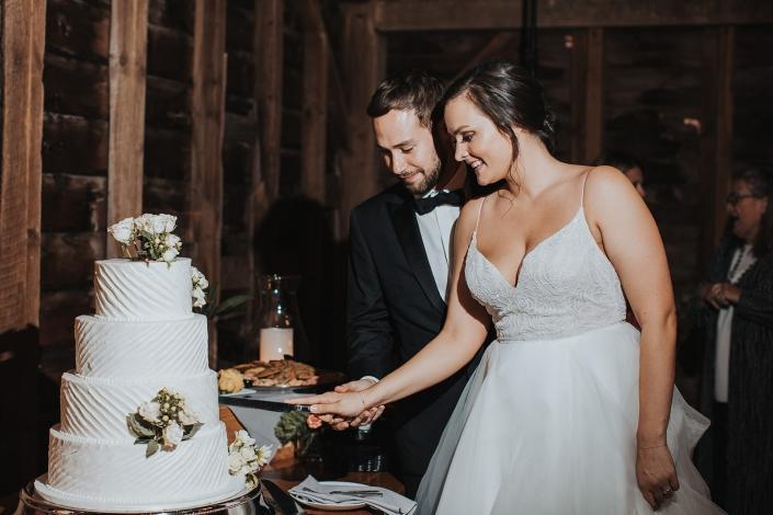 wedding cake cutting - barn wedding