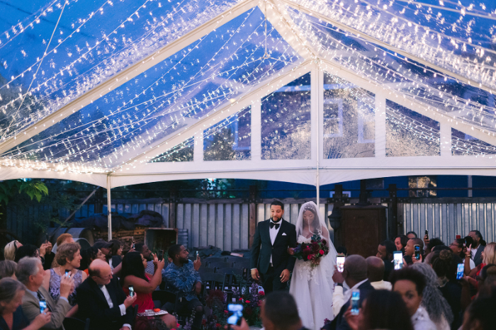 outdoor wedding tent with string lighting