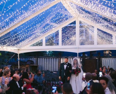 Outdoor wedding tent for at home wedding or backyard wedding with string lighting