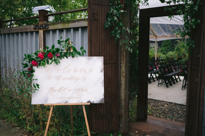 Wedding Welcome Sign with Red Florals and Greenery