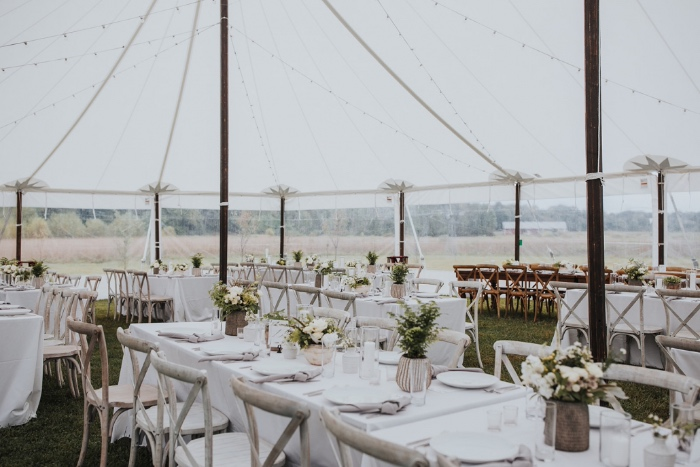 white wedding decor with greenery - classic outdoor wedding tent design