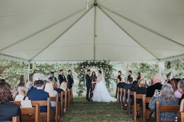 Home wedding under outdoor tent in upstate new york