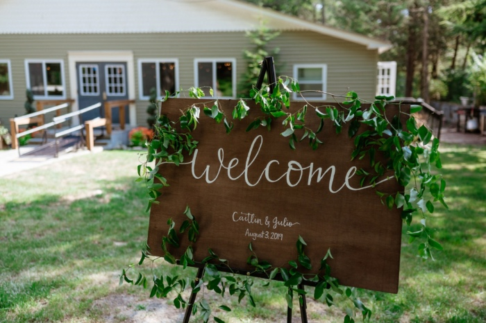 welcome sign in front of home wedding