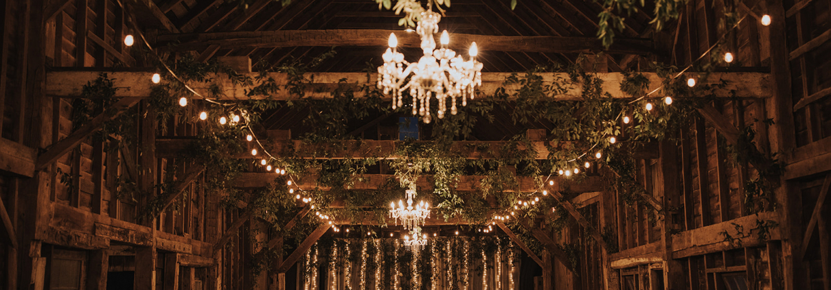 Stunning barn wedding with greenery and chandeliers in upstate new york