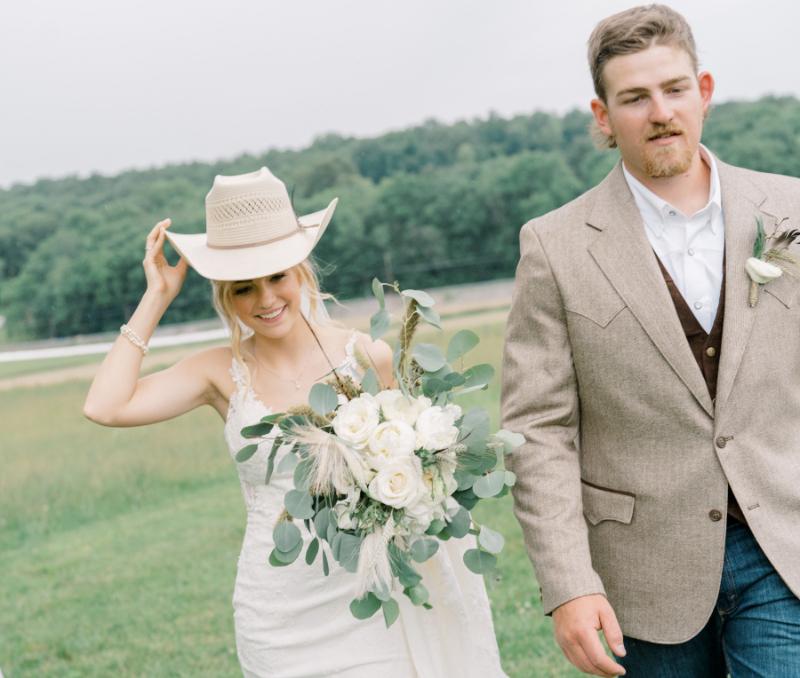 country wedding bride wears cowboy hat