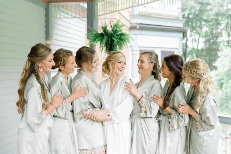 bridal party taking photos outside