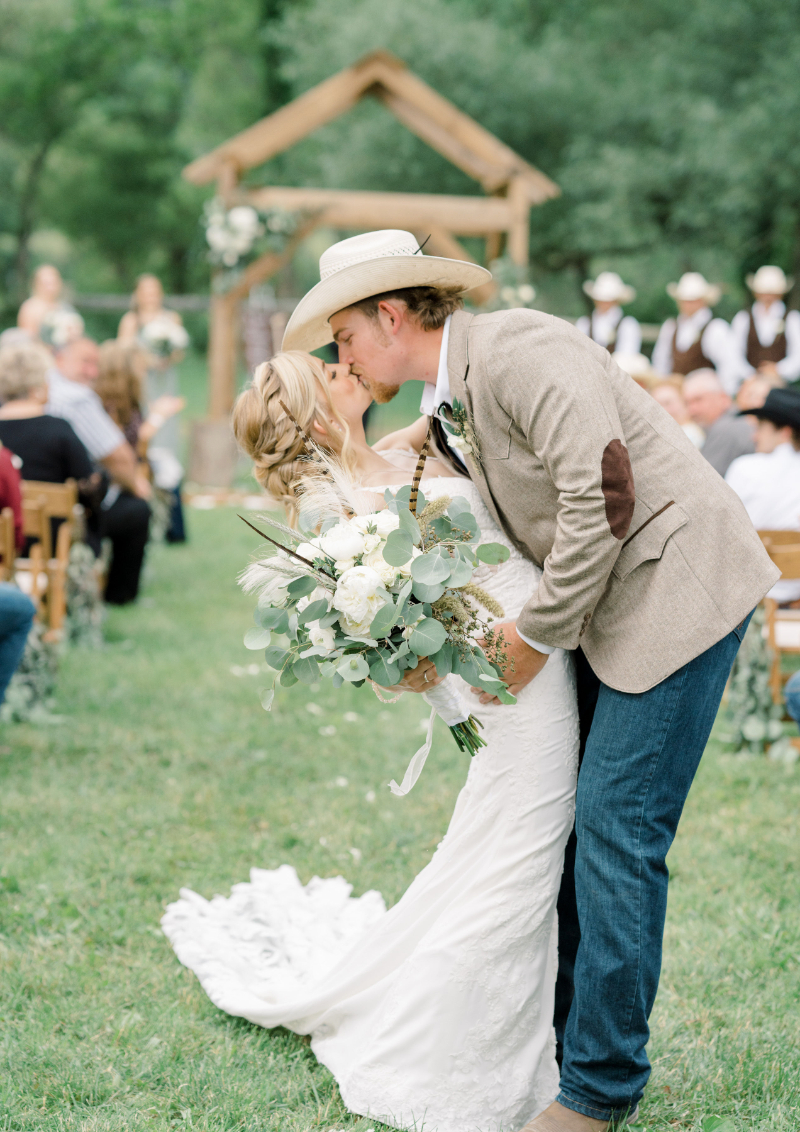 bride and groom kiss after the wedding ceremony